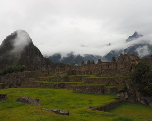 lovely shot of cloudy ruins in peru scenic green hills