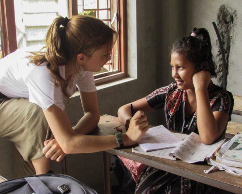 participant talking to young girl