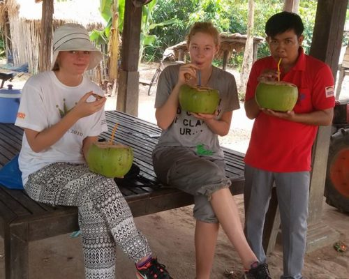 drinking fresh coconuts with friends