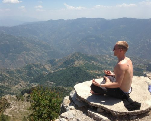 buddhist pose on a mountain