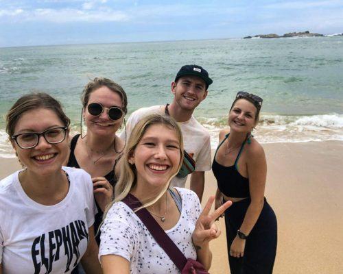 group of IVI volunteers on beach in Sri Lanka