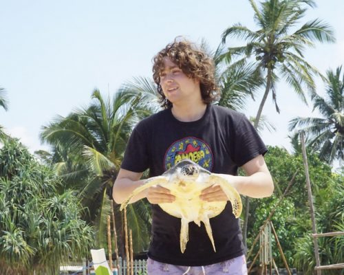 holding a large turtle