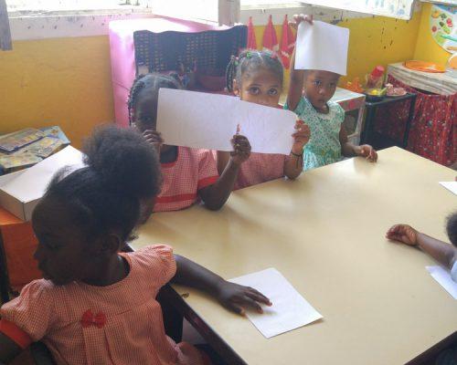 kids doing work at desk Cape Verde