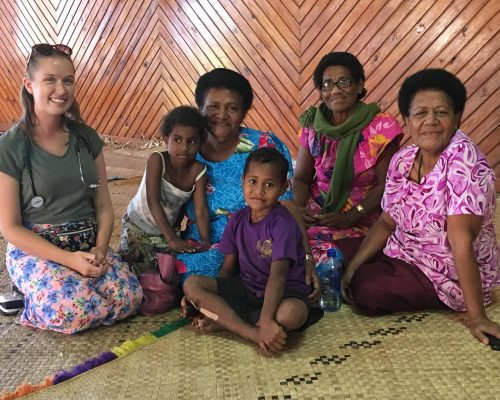 lovely shot with volunteer health worker and fijian woman and children