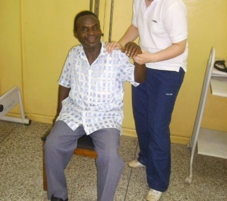 treating a local Ghanaian man in physio