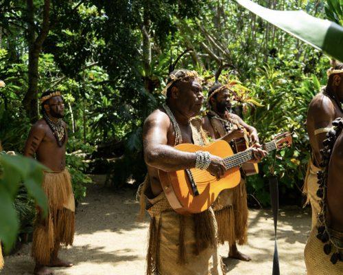 local men play guitar