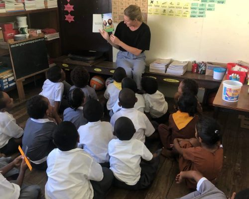 reading a book to kindergarten children in fiji