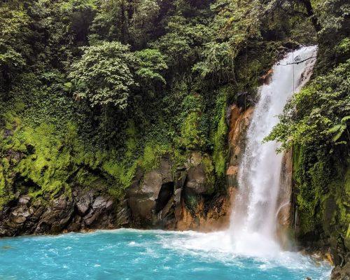 waterfall into blue pool