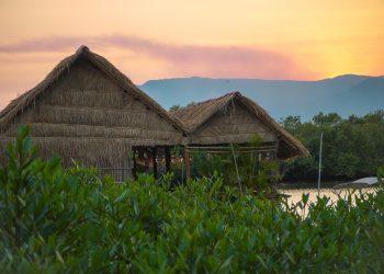 straw huts and beautiful sunset