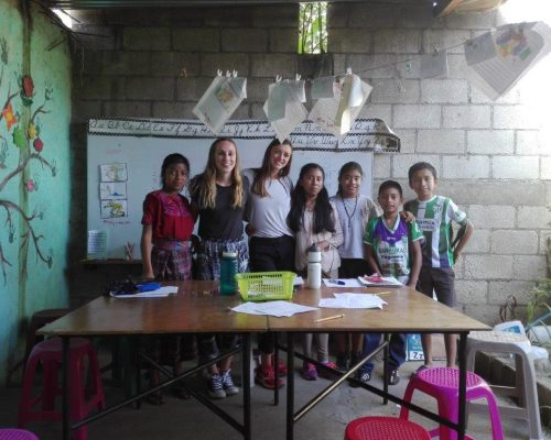 participants with students in classroom