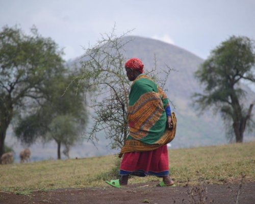 woman walking over dry land in Tanzania