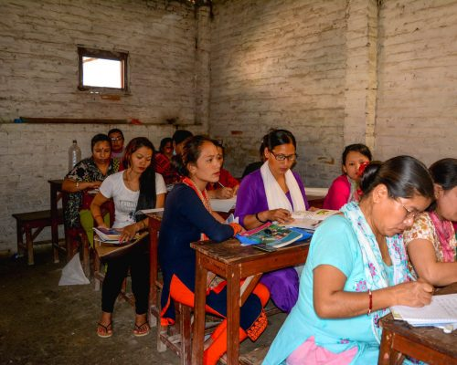 woman in the classroom with volunteers nepal